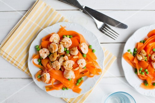 Carrot tagliatelle with prawns, peas and pine nuts