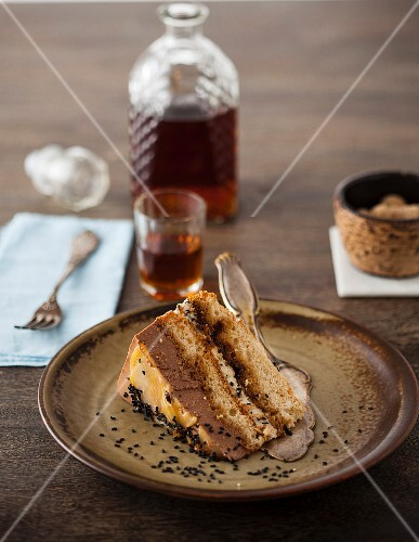 A slice of chocolate cheesecake with black sesame seeds