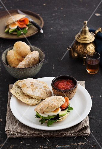 Pita bread with salmon, avocado, egg and rocket served with tomato sauce and tea