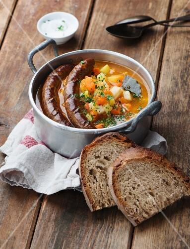 Pumpkin and potato soup with sausage