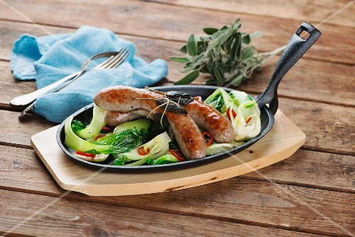 Sausages with bok choy and sage