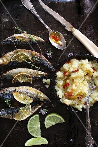 Fried mackerel and mashed potatoes with chilli oil and pine nuts