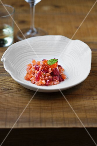 Salmon tartar with caviar, ginger, forest fruits and mint