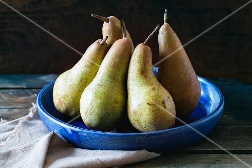 Pears in blue ceramic bowl