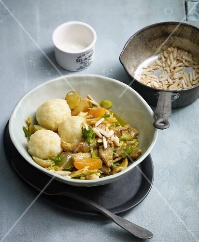 Potato dumplings with pork, apricots and grapes