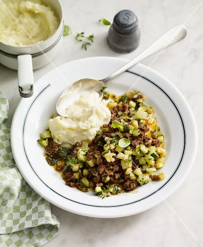 Mince meat hash with courgette and mashed potatoes