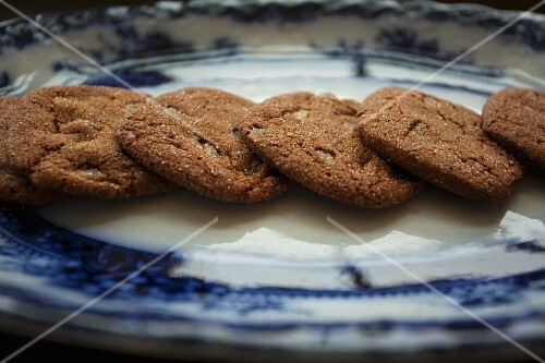 A row of ginger biscuits on a plate