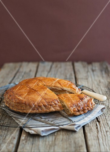 Galette des roise, sliced, on a wire rack