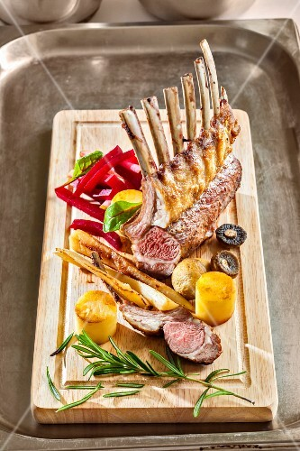 A rack of lamb with vegetables and rosemary