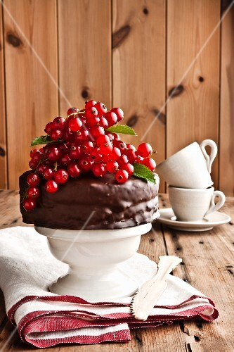A mini chocolate cake with redcurrants