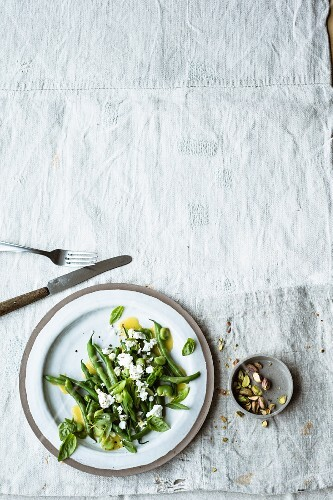 A green bean salad with feta cheese and basil