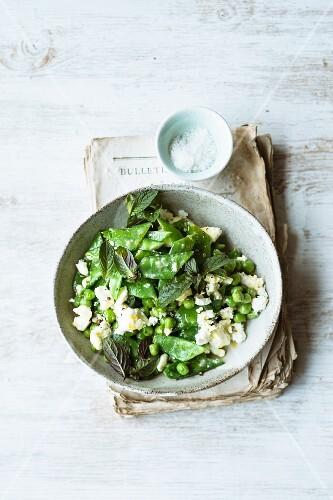 Fresh pea salad with feta cheese and a mint vinaigrette