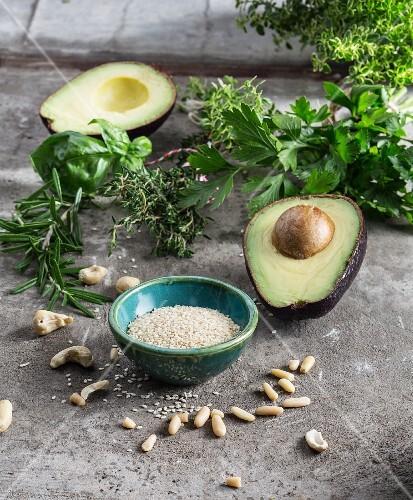 Fresh herbs, avocado, sesame seeds and pine nuts