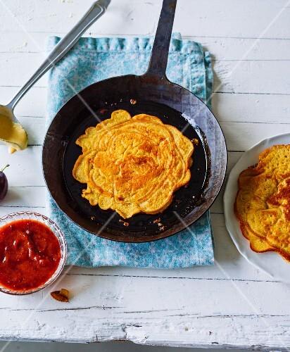 Cinnamon pancakes with homemade damson sauce