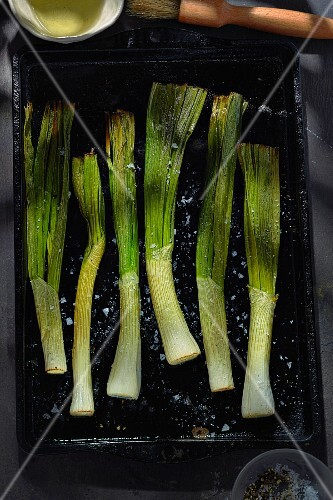 Fried spring onions on a baking tray