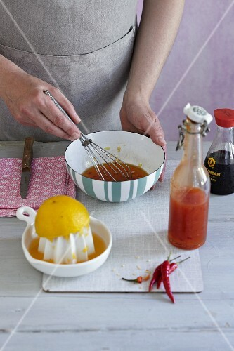 A vinaigrette being made from chilli sauce, soy sauce and orange juice