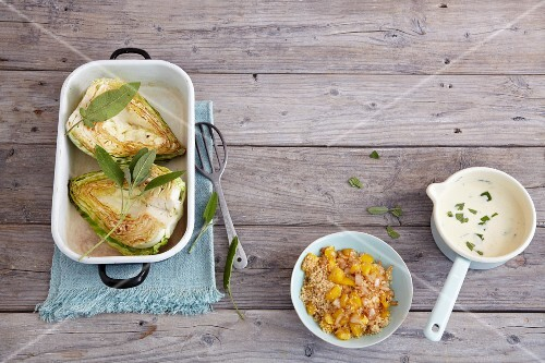 Ingredients for pointed cabbage with couscous and cheese sauce