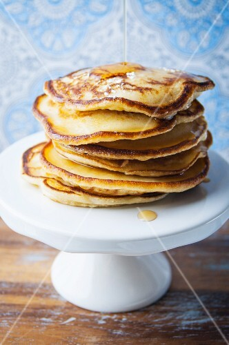 A stack of gluten-free pancakes with maple syrup