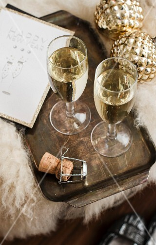 Two glasses of champagne on a tray (Christmas)