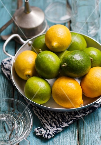 Lemons and limes in a metal bowl