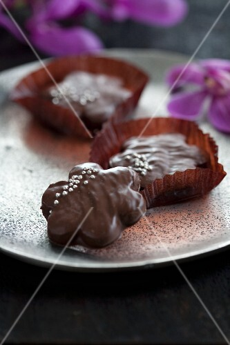 Chocolate biscuits decorated with silver pearls