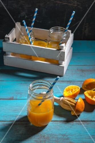 Orange juice and squeezed orange