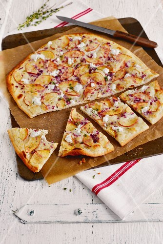 Tarte flambée with pear, red onion and goat's cheese