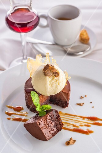 Chocolate cake with white truffle ice cream and caramel sauce