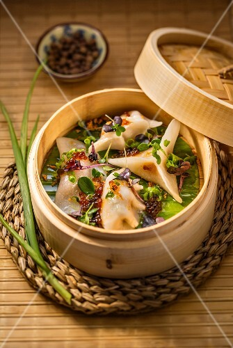 Dim sum (steamed dumpling filled with shrimps, pork and chicken, China)