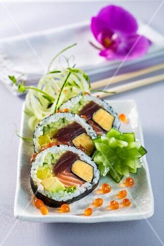 Futomaki sushi with omelette, tuna, salmon, avocado and cucumber