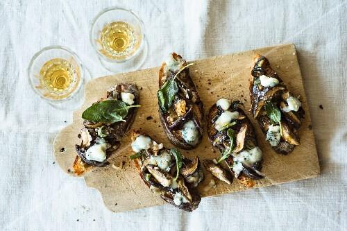 Crostini topped with sage mushrooms