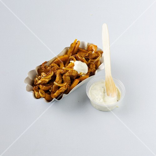 Gyros with tzatziki in a paper dish