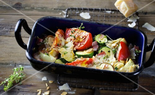 Oven-roasted vegetables with ham and flaked almonds