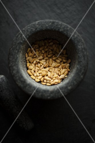 Pine nuts in a mortar (seen from above)