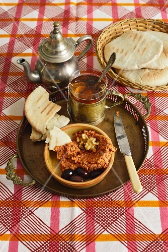 Muhammara (a Turkish dip made from pointed peppers, melba toast, walnuts and pul bibber)