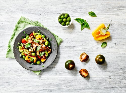 Kumato tomato salad with olives, peppers and basil