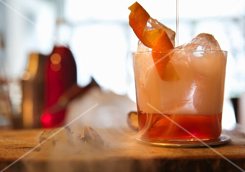 Negroni with dry ice in a bar