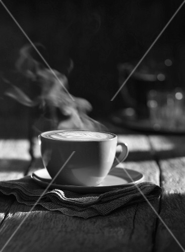 A cup of steaming cappuccino