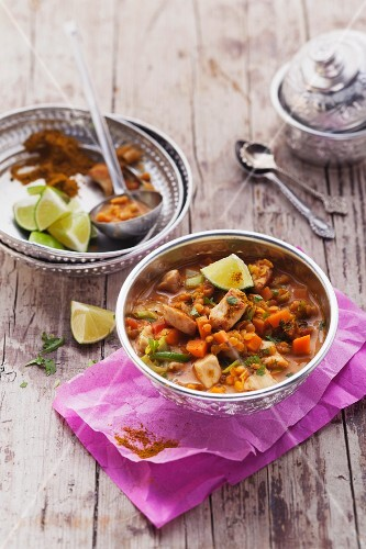 Indian lentil soup with chicken breast and coconut milk