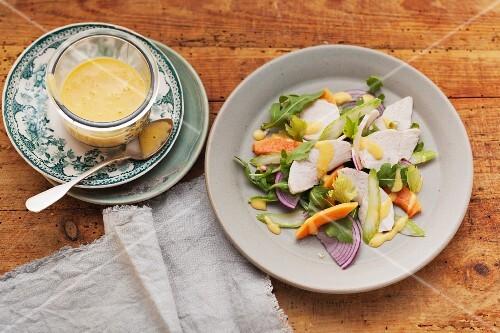 Fruity chicken breast salad with papaya and mango