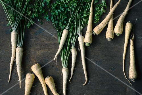 Fresh parsnips on a wooden surface