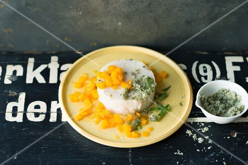 Coconut and semolina pudding with mango compote and mint sugar