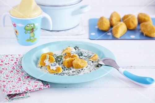 Vegetable croquettes in a creamy spinach sauce