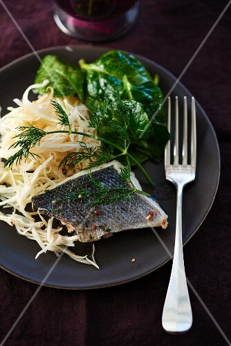 Branzini fillet with white cabbage and spinach