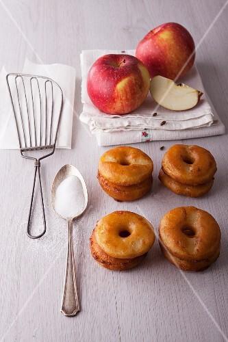 Apple doughnuts, sugar and fresh apples