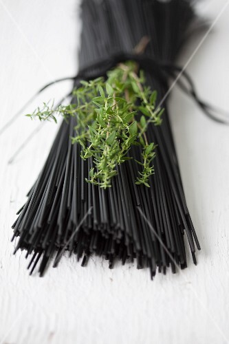 Black spaghetti coloured with coal (edible coal from Japan, for vegetarians)