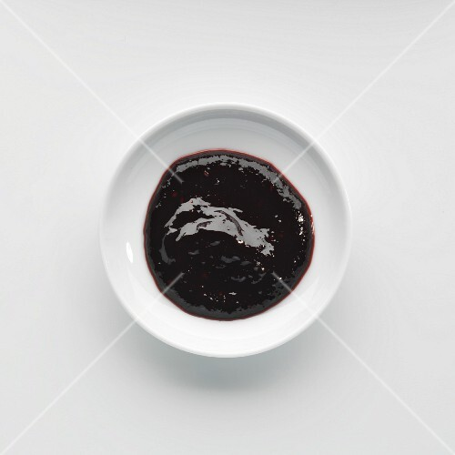 A portion of blueberry jam on a plate
