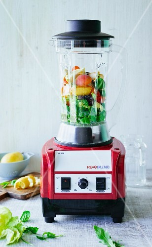 Fresh ingredients for smoothie in a blender