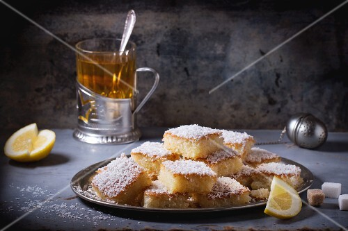 Сoconut cakes with tea and lemon wedges