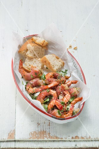 King prawns with serrano ham, herbs and baguette